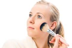 Beautiful woman applying blusher. Stock Image
