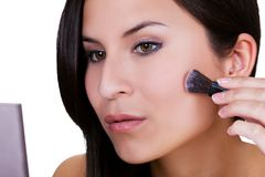 Beautiful woman applying blusher Royalty Free Stock Images