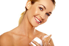 Beautiful woman applying body cream Stock Photos