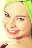 Beautiful woman applying body lotion on arm. Royalty Free Stock Photo