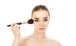 Beautiful woman applying cosmetic with brush isolated. Beautiful woman applying cosmetic with brush Stock Photos