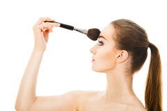 Beautiful woman applying cosmetic with brush isolated. Beautiful woman applying cosmetic with brush Royalty Free Stock Photos