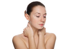 Beautiful woman applying cosmetic cream Stock Photo