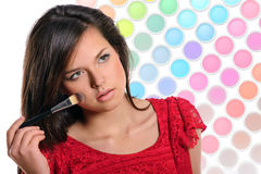 Beautiful woman applying cosmetic. Stock Photos