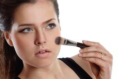 Beautiful woman applying cosmetic. Make-up Stock Image