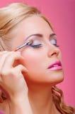 Beautiful woman applying cosmetic paint brush Royalty Free Stock Photo