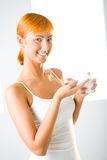 Beautiful Woman Applying Cream Stock Image