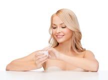 Beautiful woman applying cream Royalty Free Stock Image