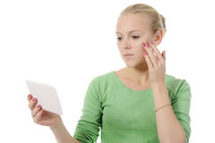 Beautiful woman applying cream on her cheek Stock Photos