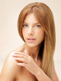 Beautiful woman applying cream on her shoulder Stock Images