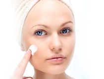 Beautiful woman applying cream. Stock Photo