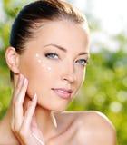Beautiful Woman Applying Cream Near Eyes Stock Photos