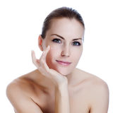 Beautiful woman applying cream on skin near eyes Stock Photography