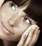 Beautiful woman applying creme Stock Images