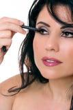 Beautiful woman applying eye pencil Stock Photo