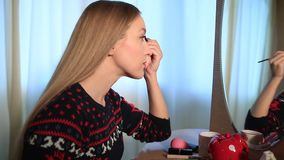 Beautiful woman applying eyebrow makeup stock video footage