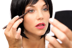 Beautiful Woman Applying Eyeliner Royalty Free Stock Images