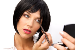 Beautiful Woman Applying Eyeliner Stock Photography