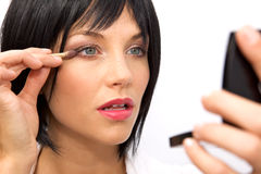 Beautiful Woman Applying Eyeshadow Royalty Free Stock Image