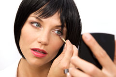 Beautiful Woman Applying Eyeshadow Stock Photo