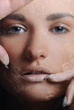 Beautiful woman applying female makeup powder Royalty Free Stock Photo