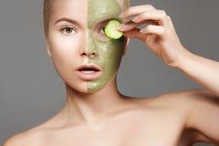 Beautiful Woman Applying Green Facial Mask. Beauty Treatments. Close-up Portrait of Spa Girl Apply Clay Facial mask Stock Photos