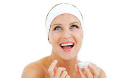 Beautiful woman applying lip balm Stock Photo