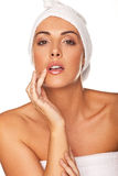 Beautiful woman applying lip gloss Royalty Free Stock Image