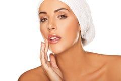 Beautiful woman applying lip gloss Royalty Free Stock Photography