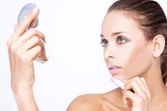 Beautiful woman applying lipstick Royalty Free Stock Photos