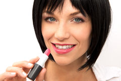 Beautiful Woman Applying Lipstick Royalty Free Stock Photos