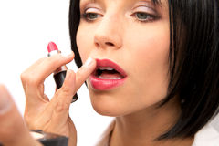 Beautiful Woman Applying Lipstick Stock Photo