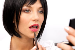 Beautiful Woman Applying Lipstick Royalty Free Stock Photo