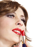 Beautiful woman applying lipstick. Stock Images