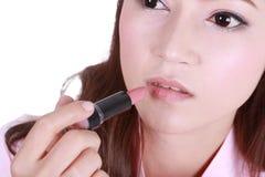 Beautiful woman applying lipstick Stock Photo