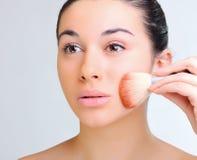 Beautiful woman applying make-up Royalty Free Stock Photo