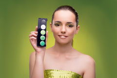 The beautiful woman applying make-up in beauty concept Stock Images