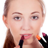Beautiful woman applying make up on face Stock Image
