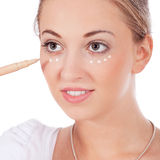 Beautiful woman applying make up on face Royalty Free Stock Photo