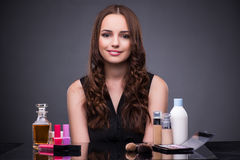The beautiful woman applying make-up in fashion concept Stock Images