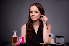 The beautiful woman applying make-up in fashion concept Royalty Free Stock Images