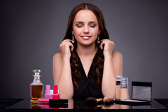 The beautiful woman applying make-up in fashion concept Royalty Free Stock Photos