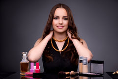 The beautiful woman applying make-up in fashion concept Royalty Free Stock Photo