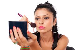 Beautiful woman applying makeup Stock Photography