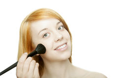 Beautiful woman applying makeup Royalty Free Stock Images