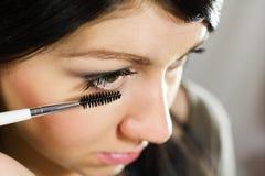 Beautiful woman applying mascara on her eye Royalty Free Stock Photography