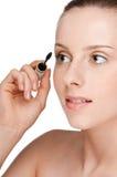 Beautiful woman applying mascara on her eyelashes Stock Image