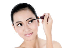 Beautiful woman applying mascara Royalty Free Stock Photos