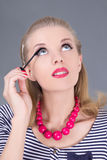 Beautiful woman applying mascara make up on eyes Royalty Free Stock Photo