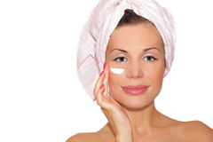 Beautiful woman applying mask. Face care, beauty treatment royalty free stock photography